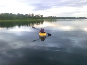 Eve on the water in a kayak