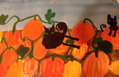 black cats in pumpkin patch