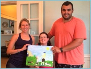 alt text= Sarah Eve and David hold a painting