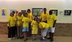 10 happy people in yellow shirts